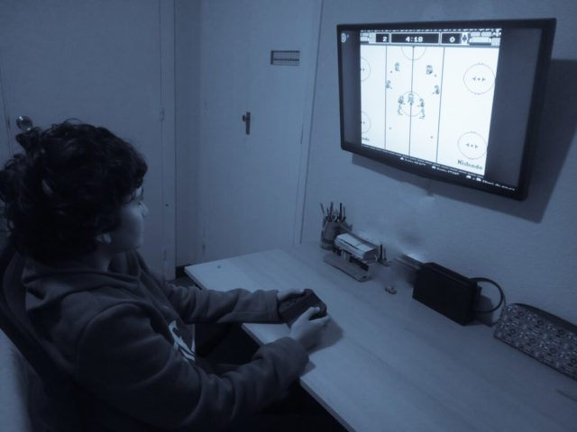My son James while playing Nintendo Ice Hockey
