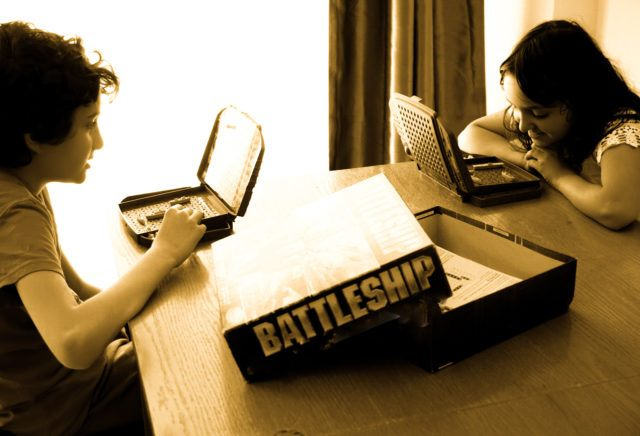 My kids playing a game of Battleship