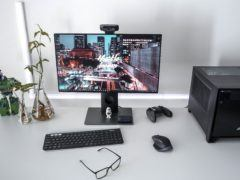 A desktop PC along with a gaming controller