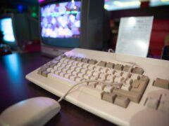 An Amiga 1200 along with a mouse